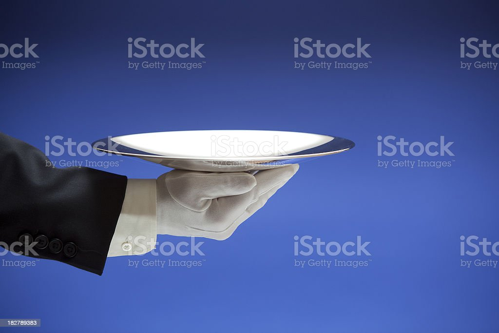 Butler Holding Empty Silver Tray on Blue XXL royalty-free stock photo