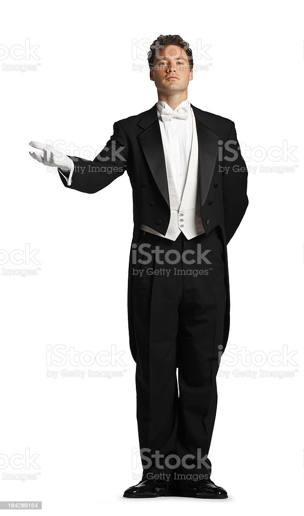 Butler or maitre d' extending his hand in welcoming gesture stock photo