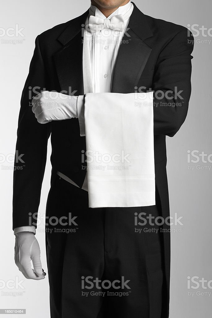 Butler or waiter wearing a white towel on his arm stock photo
