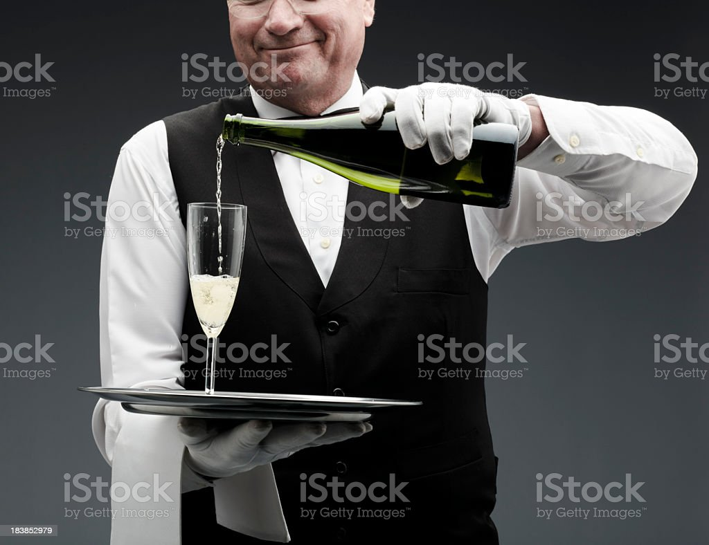 butler pouring champagne royalty-free stock photo