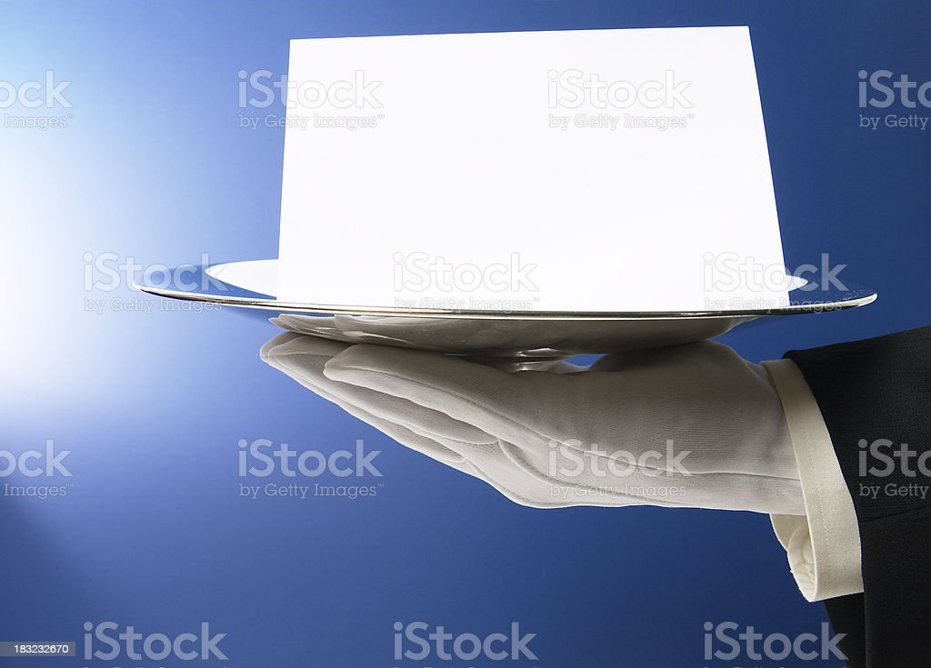 Butler Serving Blank Card on Blue stock photo