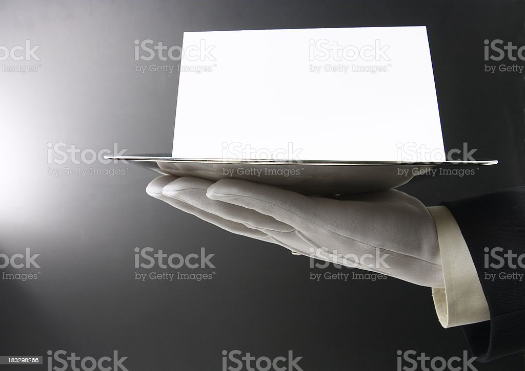 Butler Serving Blank Message on Black stock photo