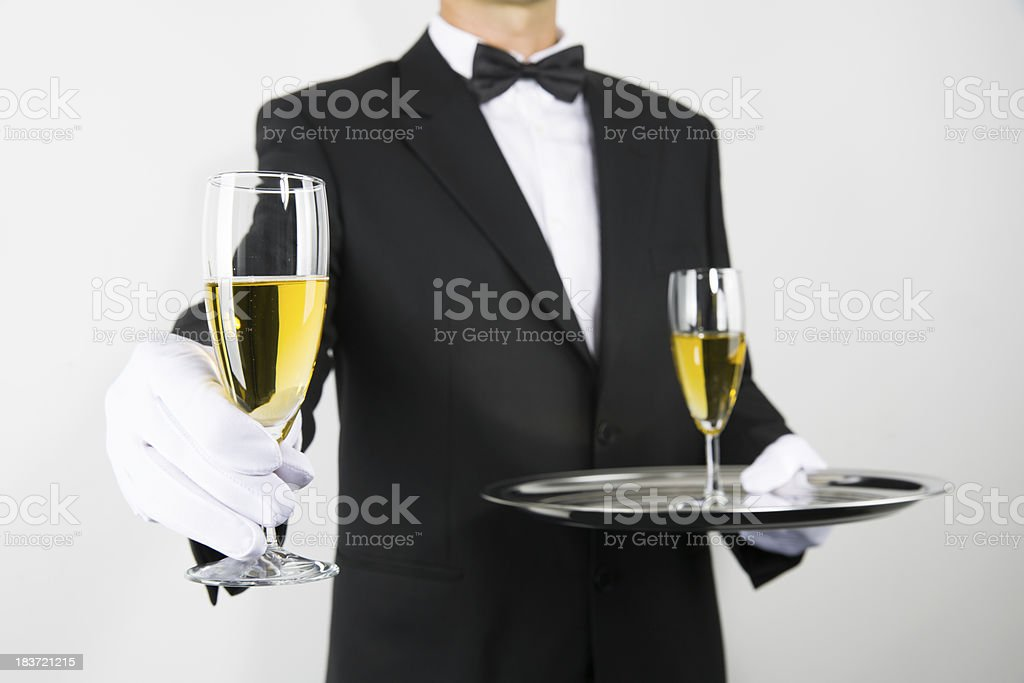 Butler Serving Champagne royalty-free stock photo