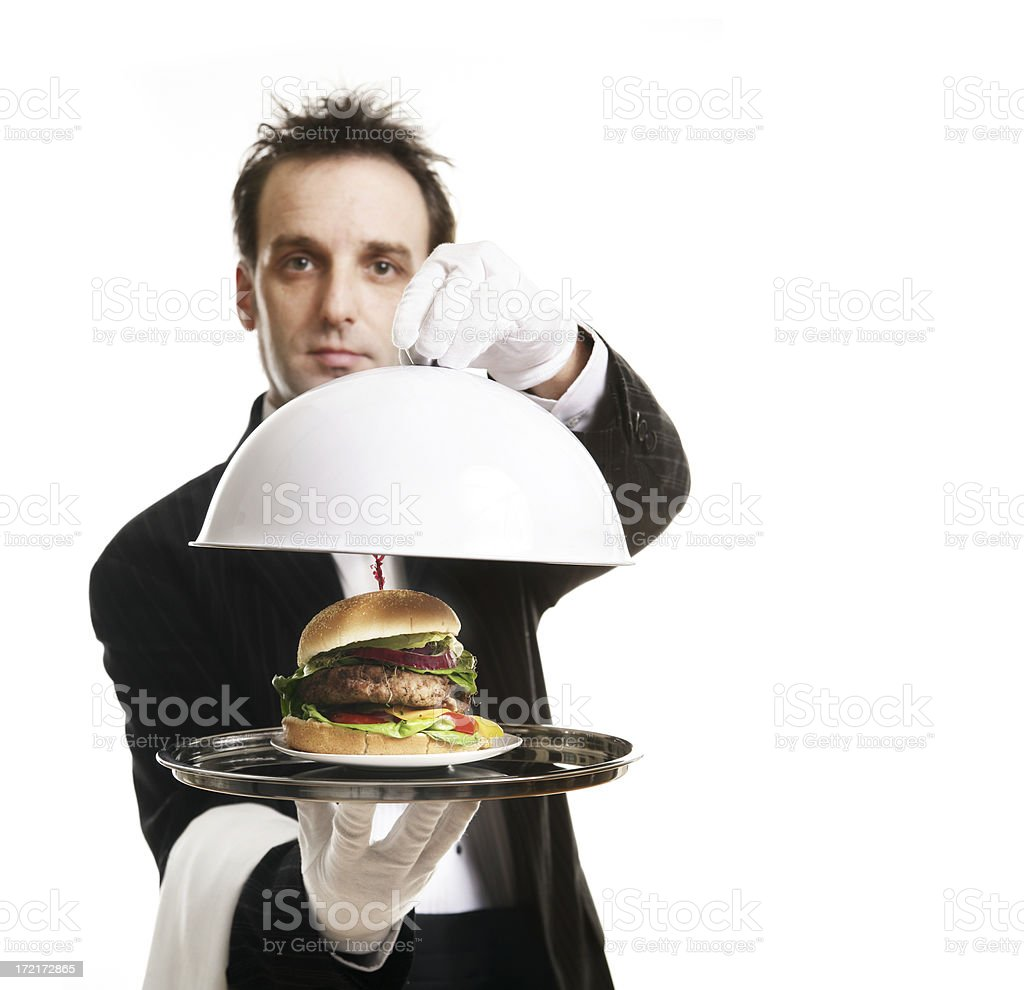 Butler serving dinner royalty-free stock photo