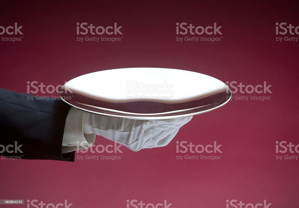 Butler Serving Empty Silver Tray on Red XXL royalty-free stock photo