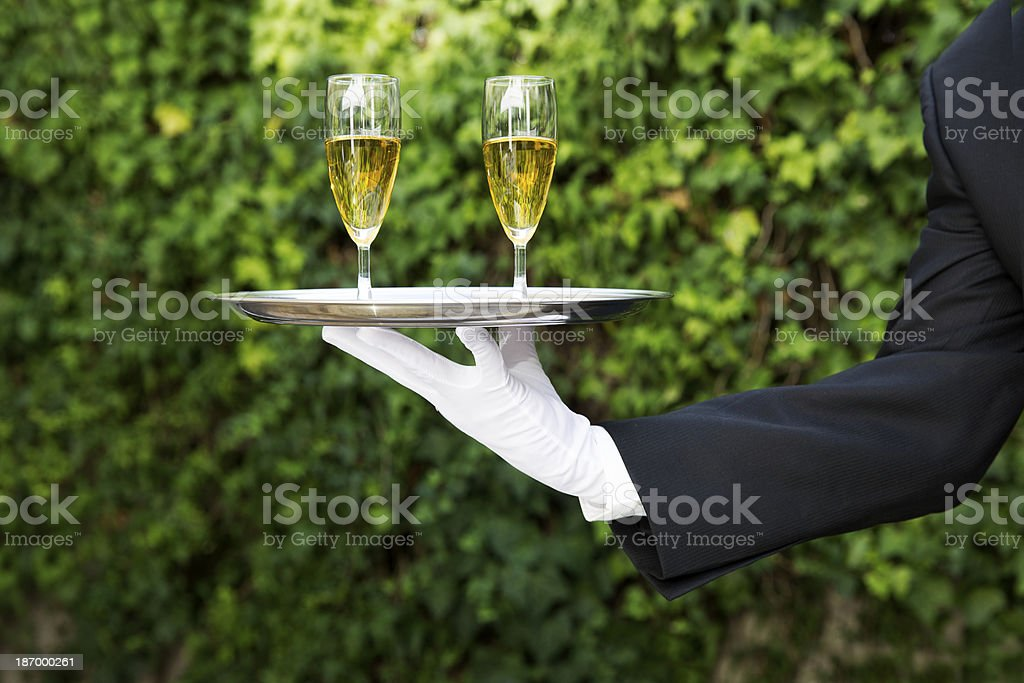 Butler Serving royalty-free stock photo