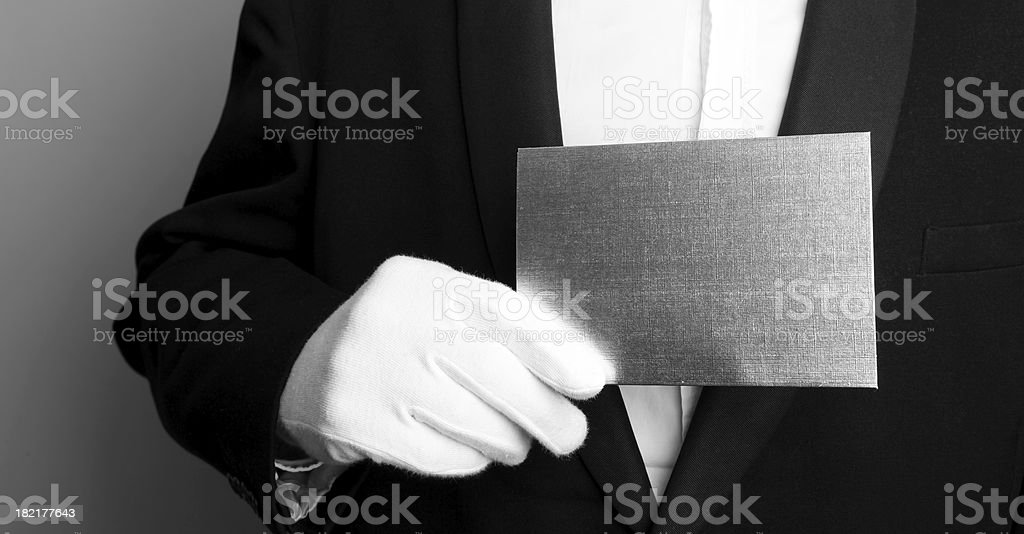 Butler with blank card stock photo
