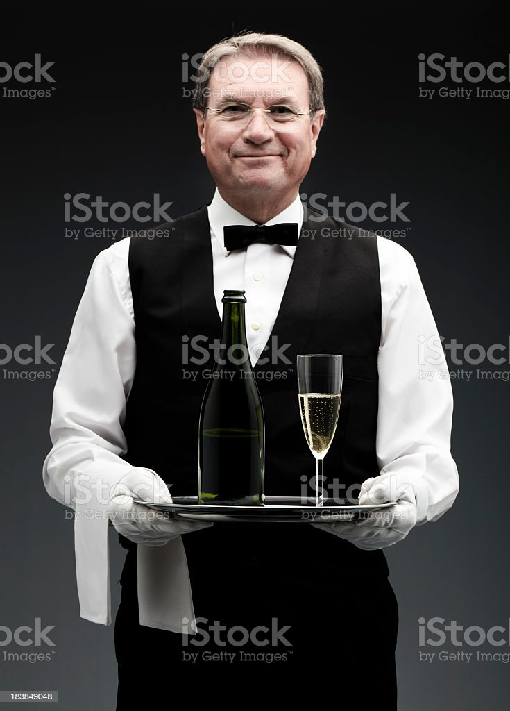 butler with champagne stock photo