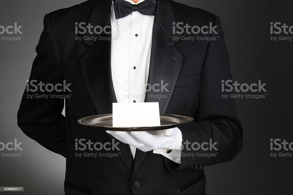 Butler With Note on Tray stock photo