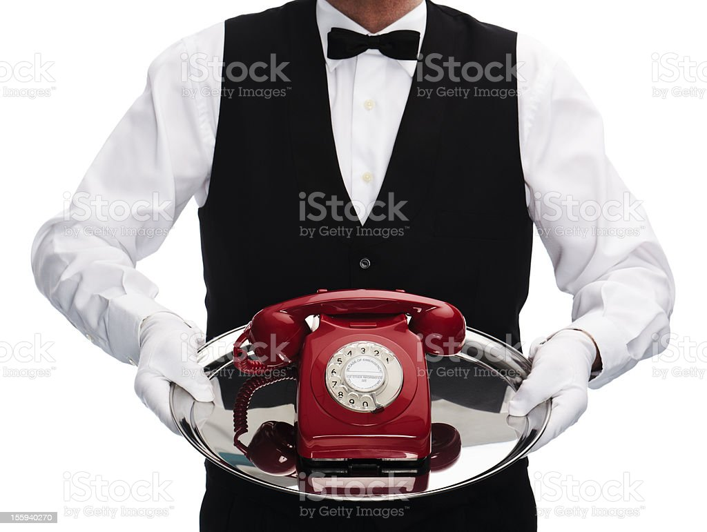 butler with rotary phone royalty-free stock photo