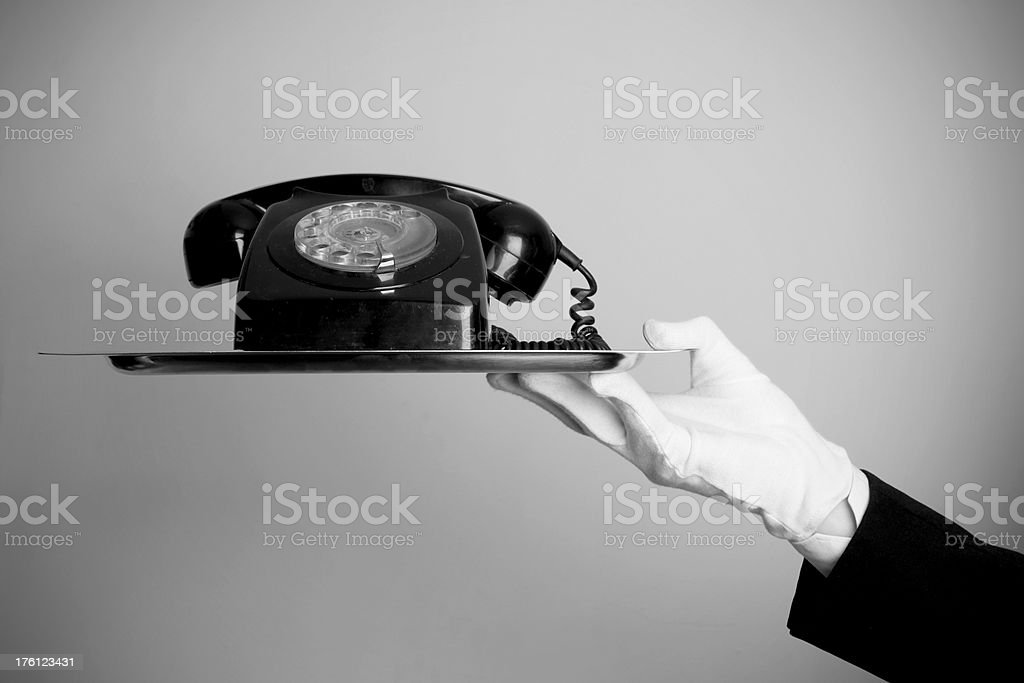 Butler with telephone royalty-free stock photo