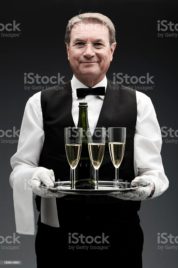 butler with three champagne flutes stock photo