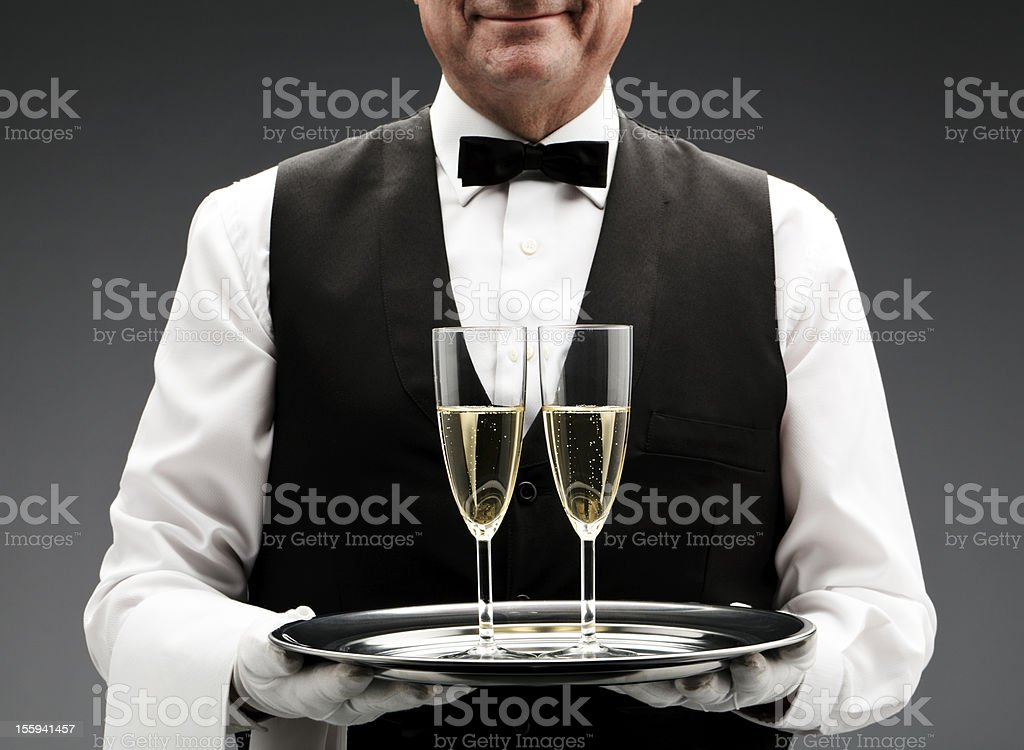 butler with two champagne flutes royalty-free stock photo