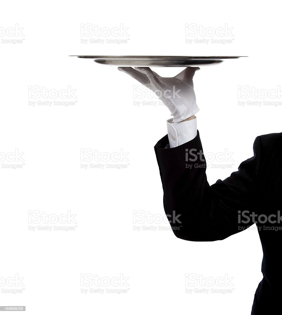Butler's gloved hand holding a silver tray stock photo
