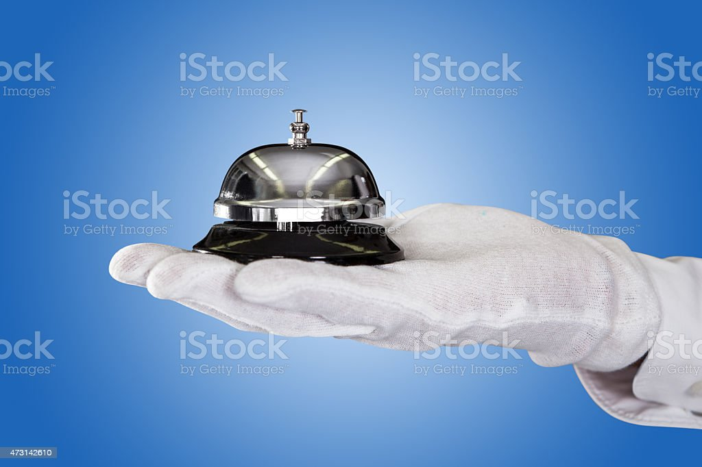 Butler's Hand Holding Service Bell stock photo