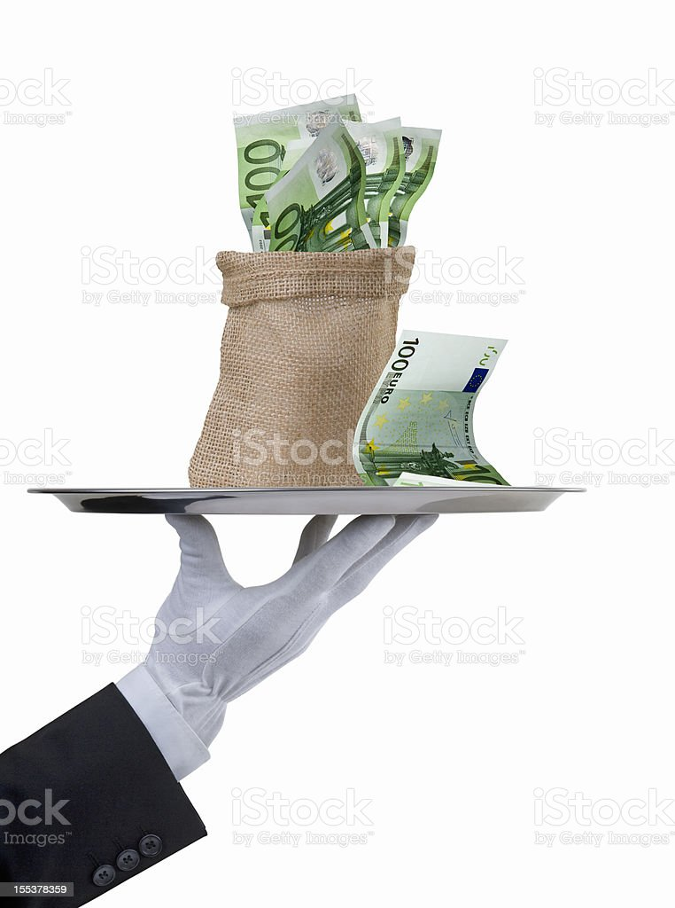 Butler's hand present a money sack royalty-free stock photo