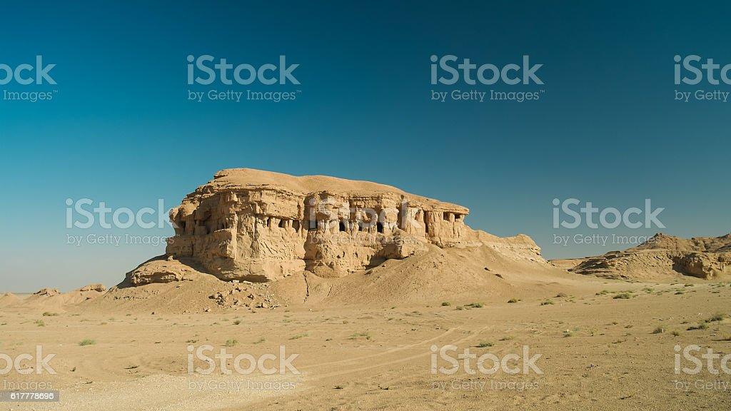 Butte at the dried shore of Razazza lake, Iraq stock photo