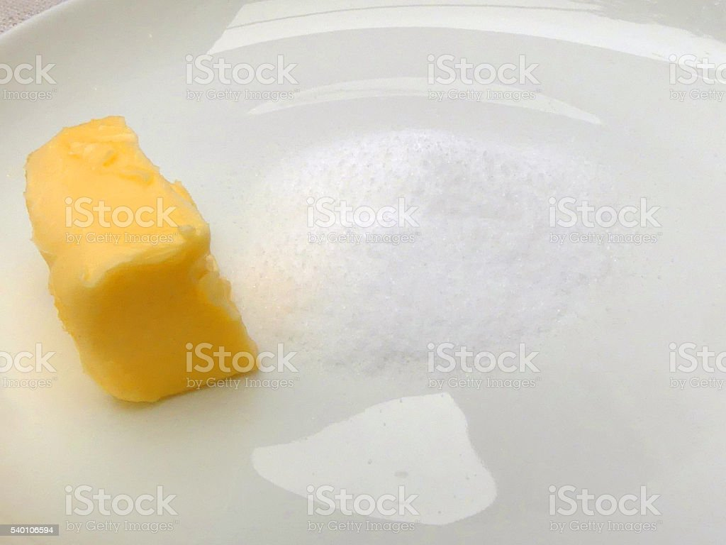 Butter and salt on white plate stock photo