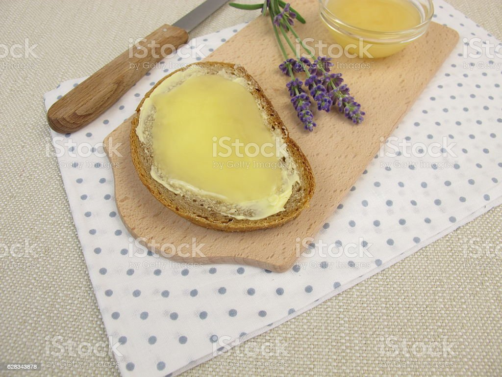 Butter bread with lavender honey stock photo