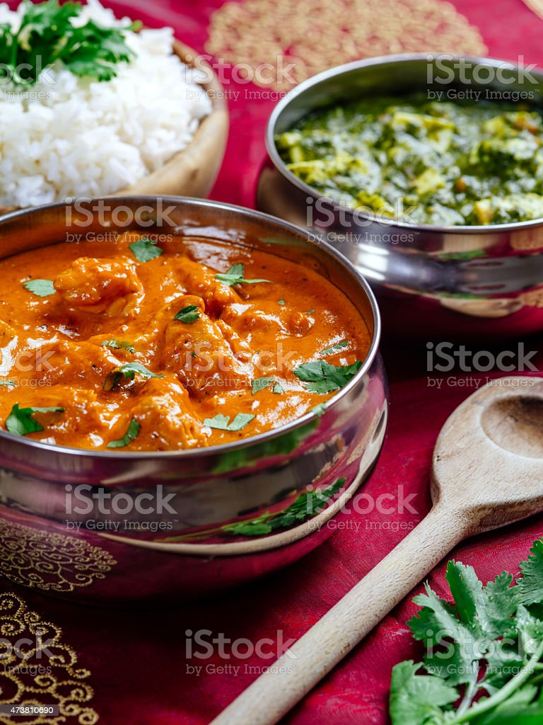 Butter chicken with rice and Saag Paneer stock photo