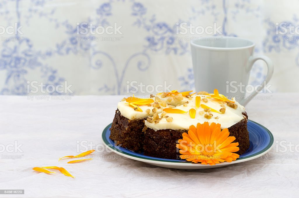 Butter cream carrot and marigold cake. stock photo