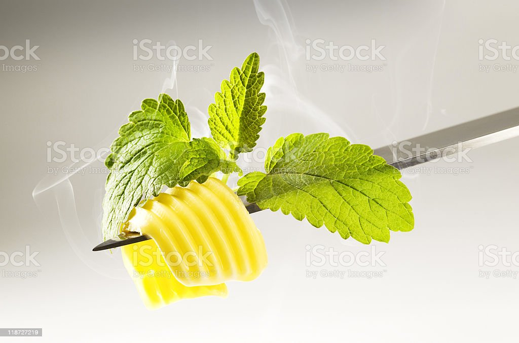 Butter curl melting  in steam stock photo