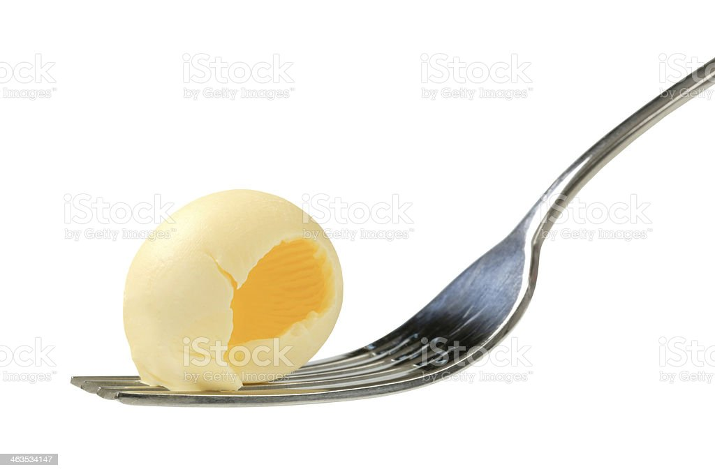 Butter curl on a fork stock photo