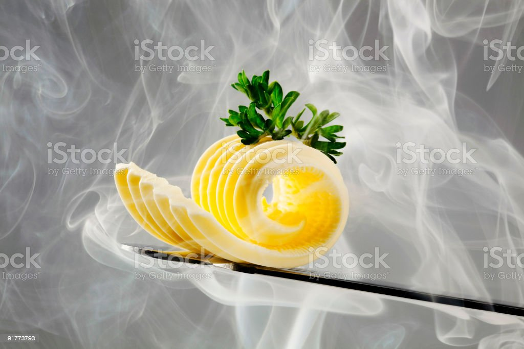 Butter curl on a knife and steam stock photo