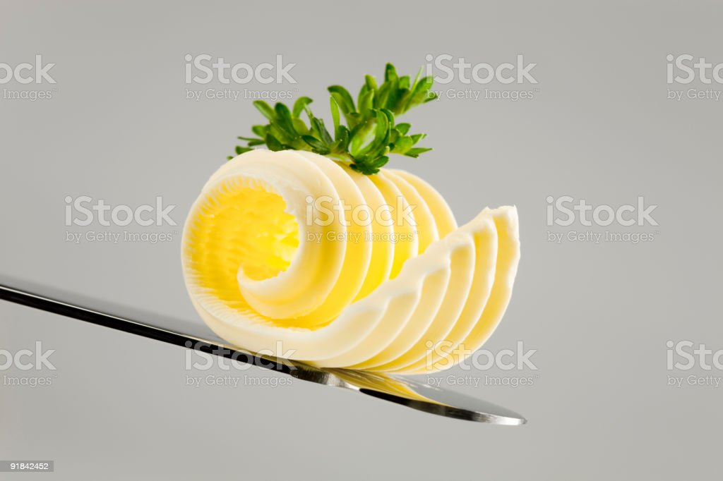 Butter curl on a knife royalty-free stock photo