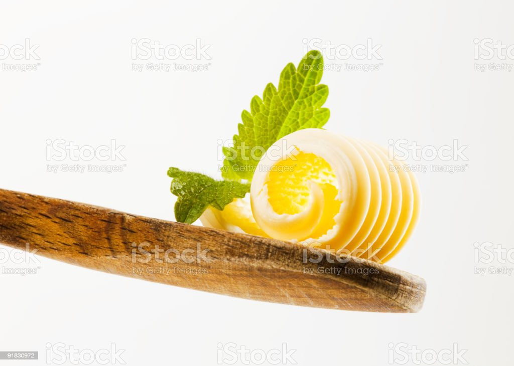 Butter curl on a wooden spoon royalty-free stock photo