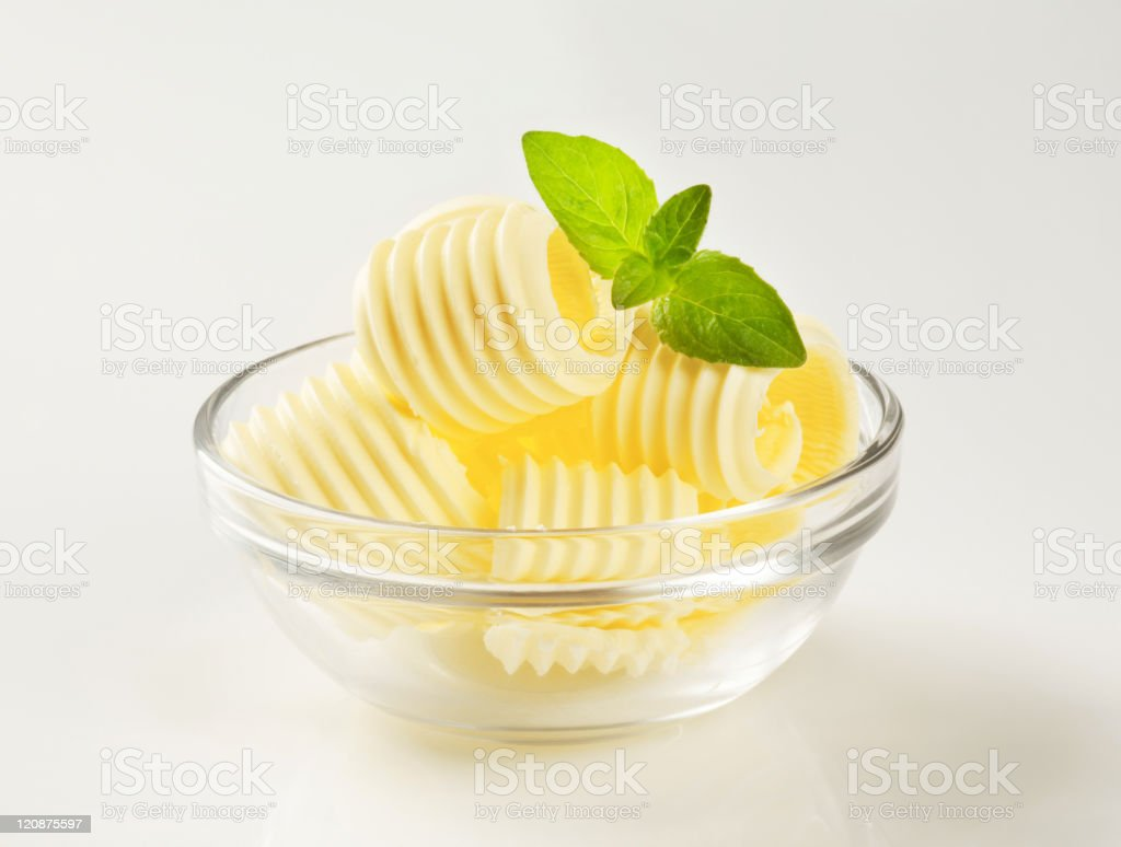 Butter curls in a glass bowl stock photo