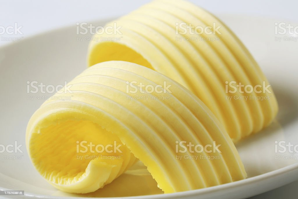 Butter curls on a plate royalty-free stock photo