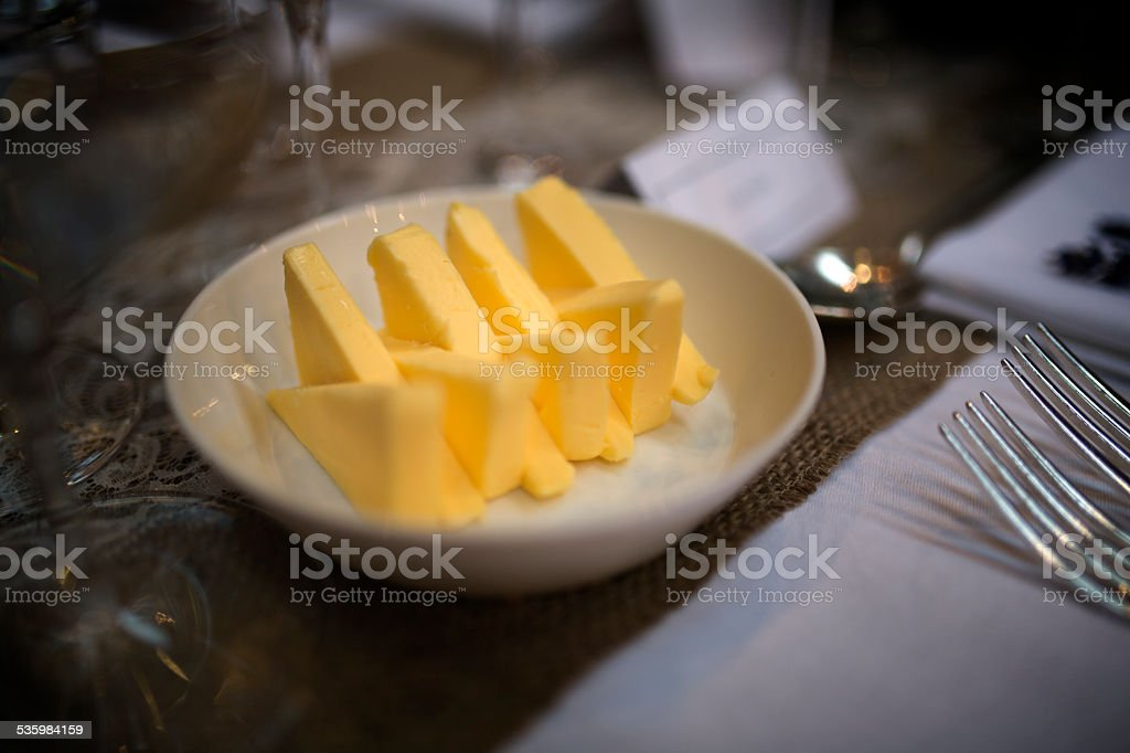 Butter cut into triangles stock photo