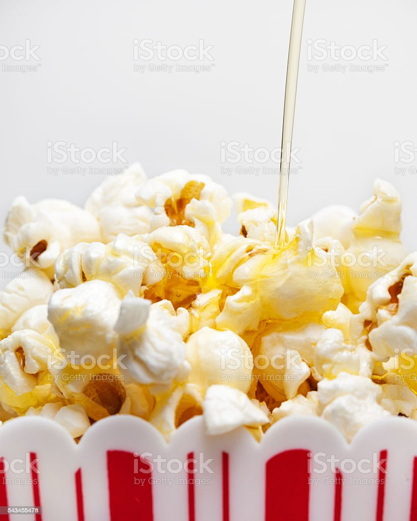 Butter Drizzling Over Popcorn stock photo