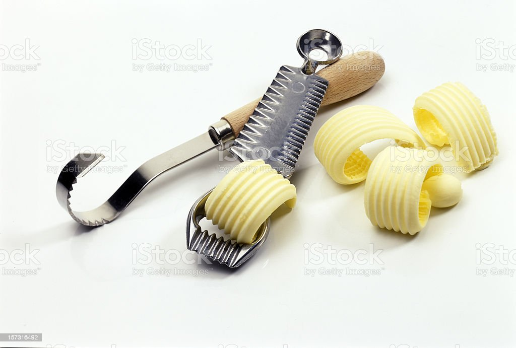 butter knives and decoration curls royalty-free stock photo