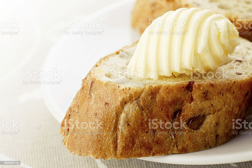 Butter on a bread stock photo