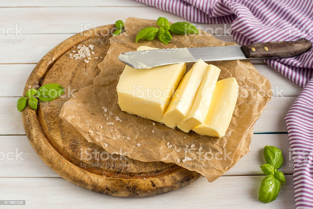 Butter on the wooden plate. dairy products. stock photo