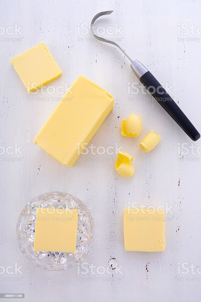 Butter on white wood table. stock photo