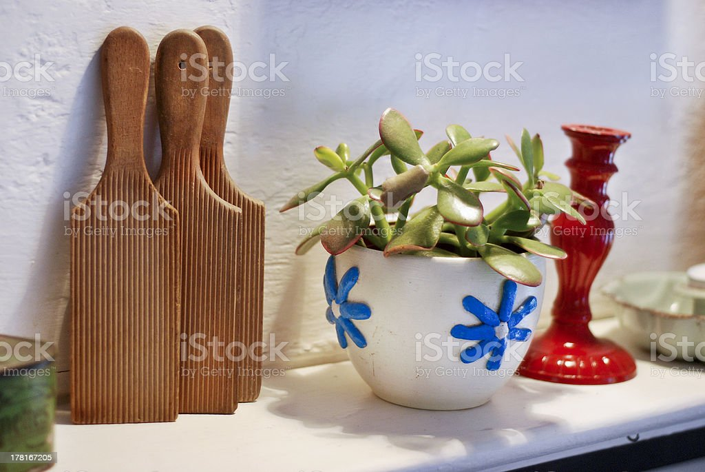 Butter paddles, vase and candlestick on a mantlepiece royalty-free stock photo