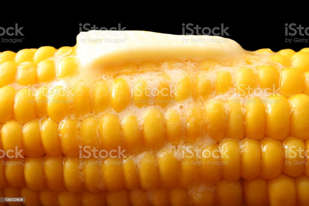 Butter Slice melting on Hot Corn, royalty-free stock photo