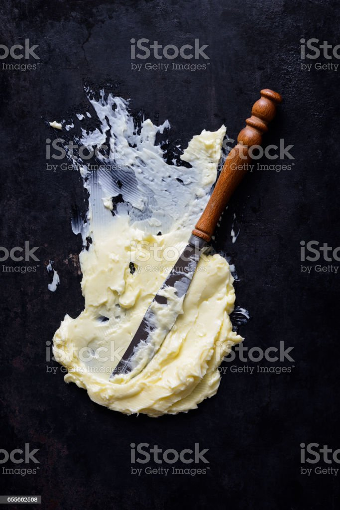 Butter spread with a knife stock photo