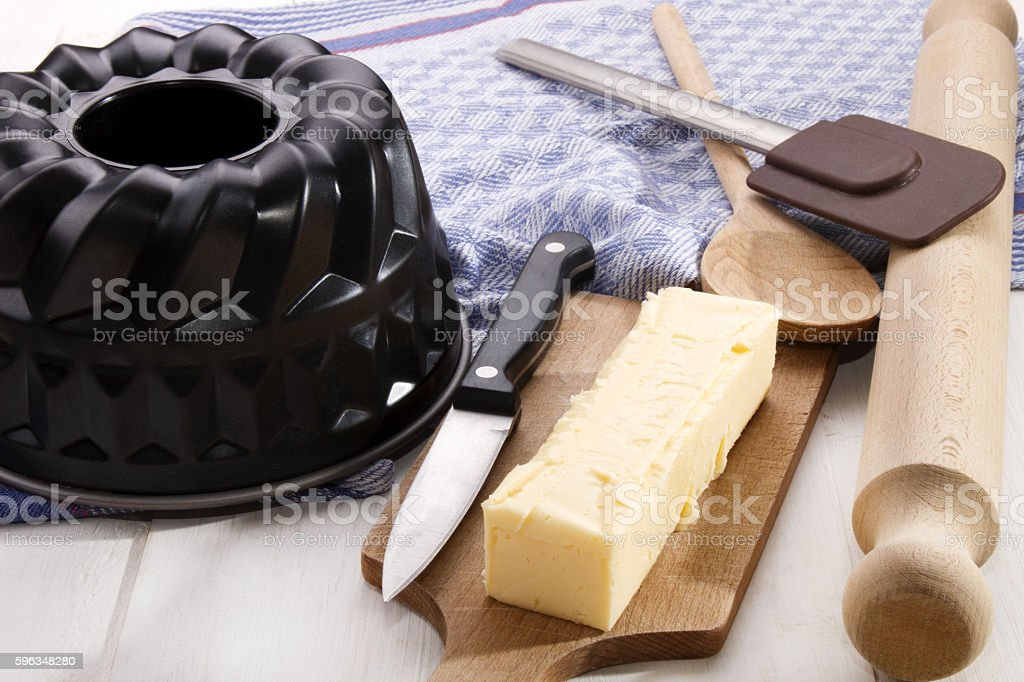 butter stick with knife on a wooden board stock photo