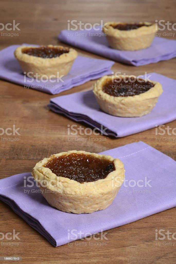 Butter tarts on purple napkin stock photo