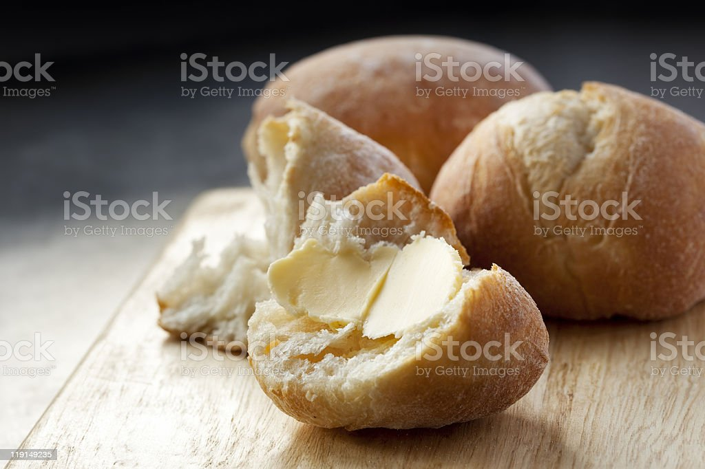 Buttered Bread Roll stock photo
