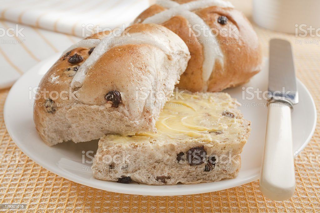 Buttered Hot Cross Buns on Yellow Cloth stock photo