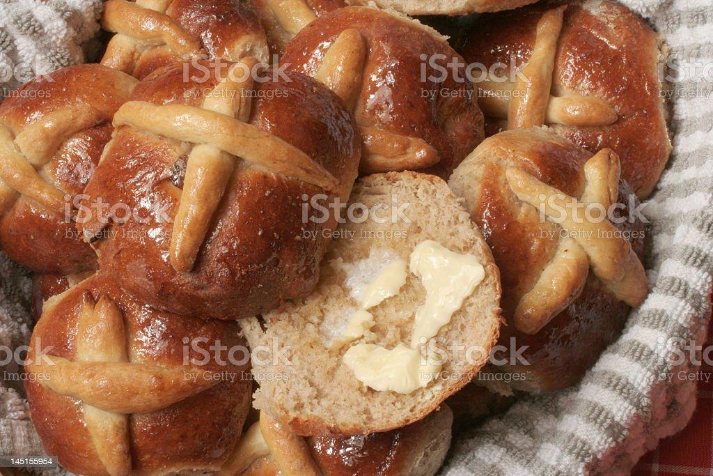 buttered hot cross buns stock photo