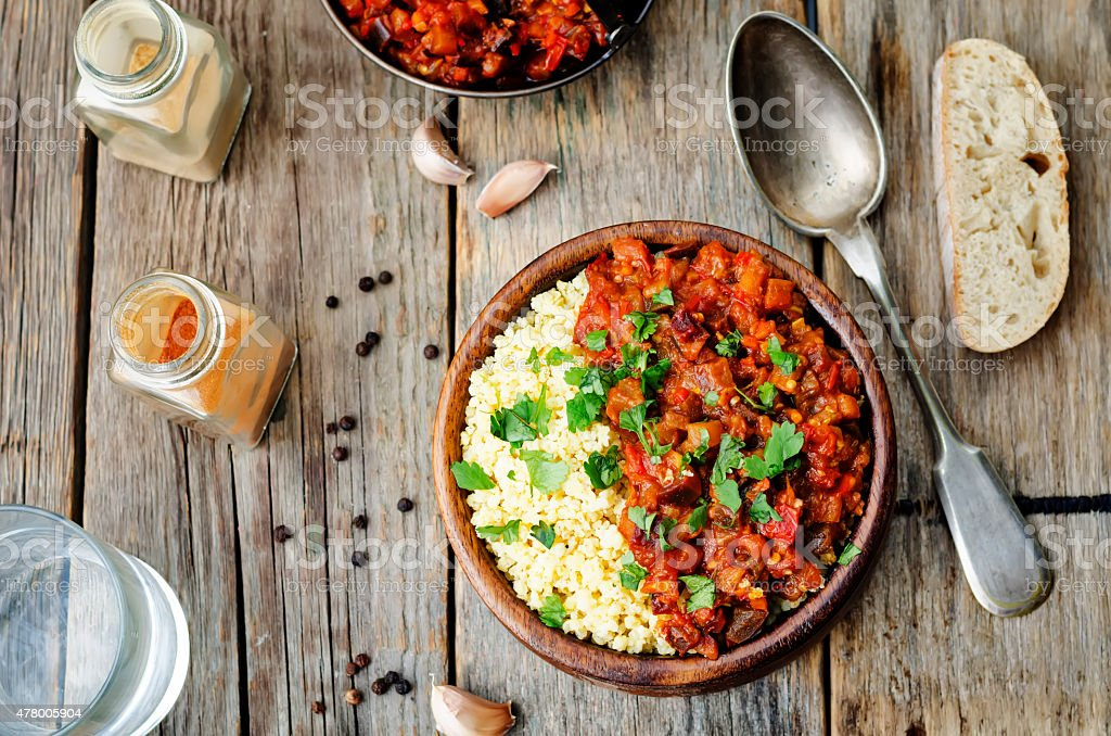 buttered millet with tomato eggplant curry stock photo