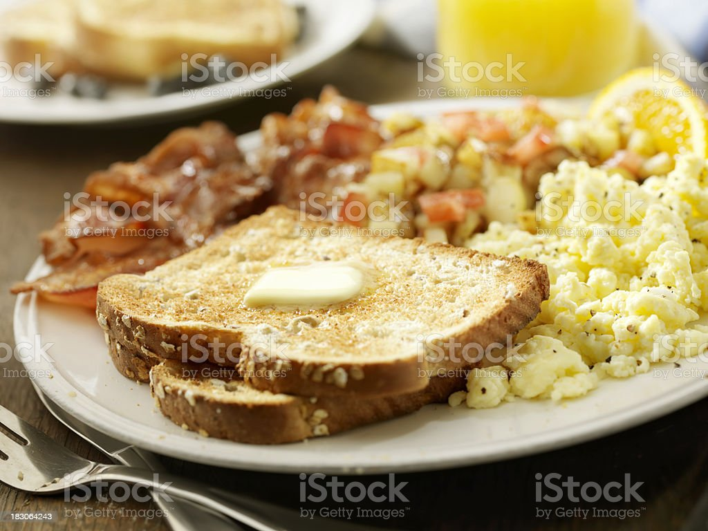 Buttered Multi Grain Toast with Bacon and Eggs royalty-free stock photo