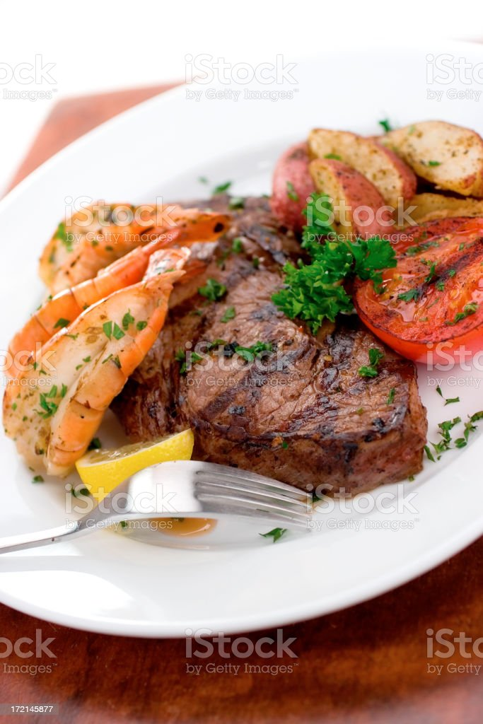 Butterflied Prawns and Steak stock photo