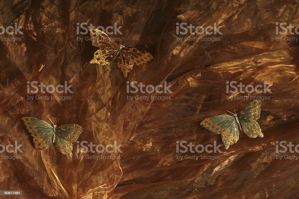 Butterflies on silky textile royalty-free stock photo